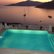 villa pool overlooking sea at sunset