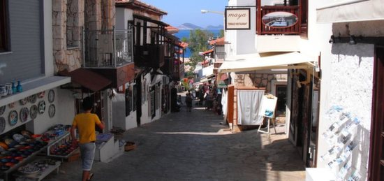 Cobbled street with Kalkan old town with small shop fronts on either side of street