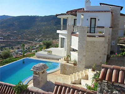 stunning two storey villa on hillside with private pool under clear blue skies